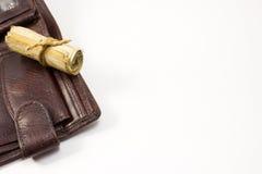 Πορτοφόλι και ένας ρόλος των χρημάτων Στοκ Εικόνες