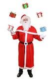 Πορτρέτο Άγιου Βασίλη που ρίχνει τα δώρα Χριστουγέννων που απομονώνονται Στοκ Φωτογραφία