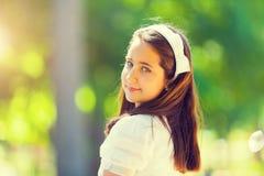 Πορτρέτο λίγο του κοριτσιού στην πρώτη ημέρα κοινωνίας της Στοκ Φωτογραφία