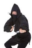Πορτρέτο αρσενικού Ninja στο μαύρο κοστούμι στοκ φωτογραφίες