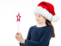 Πορτρέτο ενός λίγου κοριτσιού Χριστουγέννων με τις προσοχές ιδιαίτερες Στοκ Εικόνες