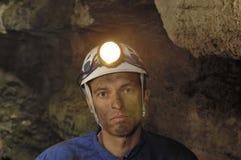 Πορτρέτο ενός ανθρακωρύχου μέσα σε ένα ορυχείο στοκ φωτογραφία