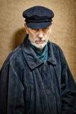 Πορτρέτο ενός ατόμου με τη γενειάδα και μια ΚΑΠ Στοκ φωτογραφία με δικαίωμα ελεύθερης χρήσης