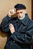 Πορτρέτο ενός ατόμου με τη γενειάδα και μια ΚΑΠ Στοκ Εικόνες