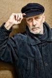 Πορτρέτο ενός ατόμου με τη γενειάδα και μια ΚΑΠ Στοκ Φωτογραφίες