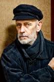 Πορτρέτο ενός ατόμου με τη γενειάδα και μια ΚΑΠ Στοκ εικόνες με δικαίωμα ελεύθερης χρήσης