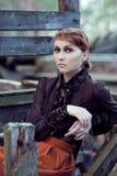 Πορτρέτο ενός νέου κοκκινομάλλους κοριτσιού στο εκλεκτής ποιότητας ύφος Στοκ Εικόνα