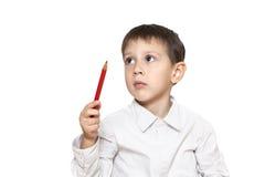 Πορτρέτο ενός στοχαστικού αγοριού με το μολύβι Στοκ Εικόνες