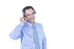 Πορτρέτο ενός χαμογελώντας επιχειρηματία με το ακουστικό Στοκ εικόνες με δικαίωμα ελεύθερης χρήσης