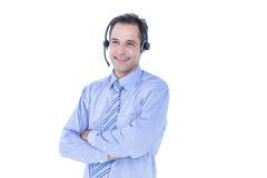 Πορτρέτο ενός χαμογελώντας επιχειρηματία με το ακουστικό Στοκ Φωτογραφία