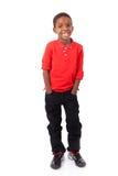 Πορτρέτο ενός χαριτωμένου μικρού παιδιού αφροαμερικάνων που χαμογελά, που απομονώνεται Στοκ Εικόνα