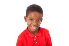 Πορτρέτο ενός χαριτωμένου μικρού παιδιού αφροαμερικάνων που χαμογελά, που απομονώνεται Στοκ Εικόνες