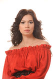Πορτρέτο ενός όμορφου κοριτσιού σε ένα κόκκινο φόρεμα σε ένα άσπρο υπόβαθρο. Στοκ φωτογραφία με δικαίωμα ελεύθερης χρήσης