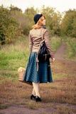 Πορτρέτο ενός όμορφου κοριτσιού redhair στο πάρκο φθινοπώρου. Στοκ Εικόνες