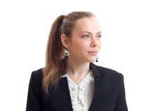 Πορτρέτο κομψού νέου ξανθού με ένα ponytail και ένα σακάκι που κοιτάζει προς την κινηματογράφηση σε πρώτο πλάνο Στοκ εικόνα με δικαίωμα ελεύθερης χρήσης