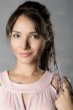 Πορτρέτο μιας γυναίκας σε ένα φόρεμα βραδιού Στοκ Φωτογραφία