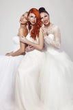 Πορτρέτο μιας όμορφης γυναίκας τρία στο γαμήλιο φόρεμα Στοκ εικόνα με δικαίωμα ελεύθερης χρήσης