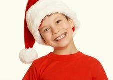 Πορτρέτο παιδιών αγοριών στο καπέλο santa, που έχει τη διασκέδαση και τις συγκινήσεις, διακοπών, κίτρινος που τονίζεται έννοια χε Στοκ εικόνες με δικαίωμα ελεύθερης χρήσης
