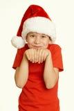 Πορτρέτο παιδιών αγοριών στο καπέλο santa, που έχει τη διασκέδαση και τις συγκινήσεις, διακοπών, κίτρινος που τονίζεται έννοια χε Στοκ Εικόνες