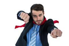 Πορτρέτο της προσποίησης επιχειρηματιών να είναι έξοχος ήρωας Στοκ Εικόνα