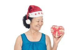 Πορτρέτο του ασιατικού ανώτερου κιβωτίου δώρων εκμετάλλευσης γυναικών Στοκ Φωτογραφίες