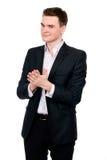 Πορτρέτο του εύθυμου επιχειρηματία σε ένα κοστούμι με τα χέρια του που ενώνονται Στοκ φωτογραφίες με δικαίωμα ελεύθερης χρήσης