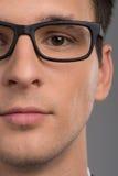 Πορτρέτο του μισού προσώπου του ατόμου που εξετάζει τη κάμερα Στοκ Φωτογραφίες