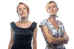 Πορτρέτο των γυναικών στα φορέματα στο άσπρο υπόβαθρο Στοκ Φωτογραφία