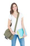 Πορτρέτο των ευτυχών θηλυκών βιβλίων εκμετάλλευσης φοιτητών πανεπιστημίου και της τσάντας ώμων Στοκ φωτογραφία με δικαίωμα ελεύθερης χρήσης