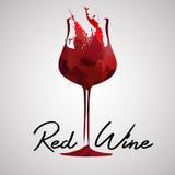 Ποτήρι του κρασιού φιαγμένου από ζωηρόχρωμους παφλασμούς κόκκινους Στοκ Φωτογραφίες