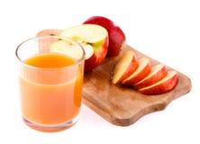 Ποτήρι του χυμού και του μήλου Στοκ Εικόνες