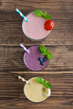 Ποτήρι τρία των φρούτων milkshakes στοκ φωτογραφίες με δικαίωμα ελεύθερης χρήσης