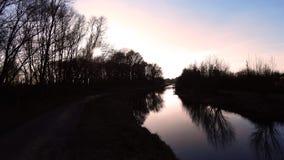 Ποταμός στο ηλιοβασίλεμα Στοκ Φωτογραφίες