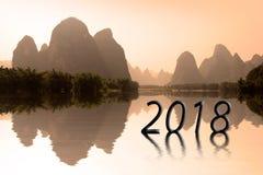 2018 που γράφεται στο ασιατικό τοπίο στο ηλιοβασίλεμα Στοκ Εικόνα