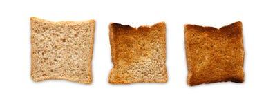 Που μαγειρεύεται φρυγανιά και που καίγεται Βαθμός toastiness στο λευκό στοκ φωτογραφίες