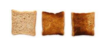 Που μαγειρεύεται φρυγανιά και που καίγεται Βαθμός toastiness στο λευκό στοκ φωτογραφίες με δικαίωμα ελεύθερης χρήσης