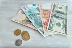 Πολλά χρήματα, ρούβλια, δολάρια Στοκ Εικόνες