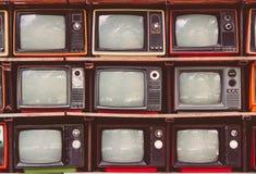 Πολλή ζωηρόχρωμη παλαιά τηλεόραση διακοσμεί στον εκλεκτής ποιότητας τόνο καφετεριών Στοκ φωτογραφίες με δικαίωμα ελεύθερης χρήσης