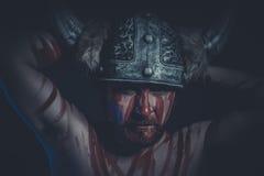 Πολεμιστής Βίκινγκ με ένα κερασφόρο χρώμα κρανών και πολέμου στο πρόσωπό του Στοκ Φωτογραφίες