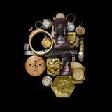 Πολλοί παλαιό ρολόι στο μαύρο υπόβαθρο Στοκ Εικόνες