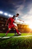 Ποδοσφαιριστές στο πανόραμα δράσης Στοκ Εικόνες