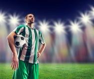 Ποδοσφαιριστής με μια σφαίρα Στοκ Φωτογραφίες