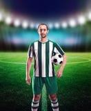 Ποδοσφαιριστής με μια σφαίρα Στοκ Εικόνα