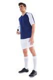 Ποδοσφαιριστής στην μπλε στάση με τη σφαίρα Στοκ Εικόνες