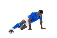 Ποδοσφαιριστής στο μπλε λάκτισμα Στοκ Φωτογραφία