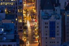 Πολυάσχολες οδοί πόλεων τη νύχτα Στοκ Εικόνες