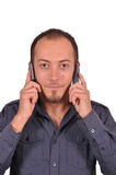 Πολυάσχολος τύπος με δύο κινητά τηλέφωνα Στοκ Εικόνες