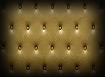 Πολυτελής σκοτεινή χρυσή ταπετσαρία καθισμάτων δέρματος Στοκ Εικόνες