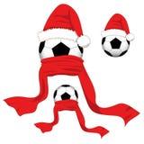 ποδόσφαιρο γυαλιού καψίματος σφαιρών aqua Σφαίρα ποδοσφαίρου με το καπέλο Santa και το κόκκινο μαντίλι Ημέρα των Χριστουγέννων επ Στοκ εικόνα με δικαίωμα ελεύθερης χρήσης