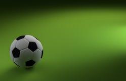 Ποδόσφαιρο στο πράσινο υπόβαθρο Στοκ φωτογραφία με δικαίωμα ελεύθερης χρήσης